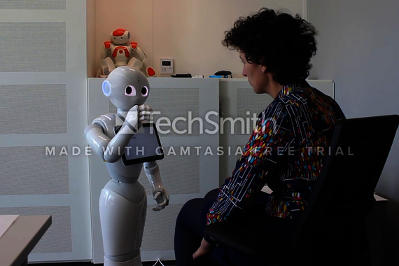 An actress in conversation with a Pepper robot. The answers are provided real-time via the internet by crowd workers. Video | Tahir Abbas